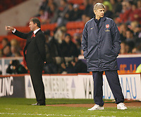 Photo: Steve Bond.<br /> Sheffield United v Arsenal. Carling Cup. 31/10/2007. Arsene Wenger (R) looks unconcerned. Bryan Robson stands in the background