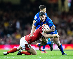 Luca Morisi of Italy is tackled by Dan Biggar of Wales<br /> <br /> Photographer Simon King/Replay Images<br /> <br /> Six Nations Round 1 - Wales v Italy - Saturday 1st February 2020 - Principality Stadium - Cardiff<br /> <br /> World Copyright © Replay Images . All rights reserved. info@replayimages.co.uk - http://replayimages.co.uk