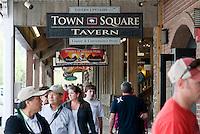 Tourists mill around businesses on the Jackson Town Square, Jackson, Wyo.