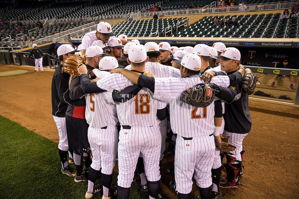 The Maryland Terrapins huddle prior to a 2015 Big Ten Conference Tournament game between the Maryland Terrapins and Michigan State Spartans at Target Field on May 20, 2015 in Minneapolis, Minnesota. (Brace Hemmelgarn)