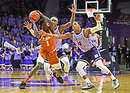 David Sloan #4 and Cartier Diarra #2 of the Kansas State Wildcats pressure Andrew Jones #1 of the Texas Longhorns during the second half at Bramlage Coliseum on February 22, 2020 in Manhattan, Kansas.