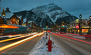 The town of Banff at nightfall, with Mt. Cascade in the background.