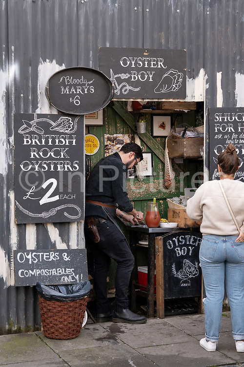 A small shack selling British Rock Oysters at Columbia Road Flower Market on the 6th October 2019 in London in the United Kingdom. Columbia Road Flower Market is a street market in Bethnal Green in Hackney, London. The market is open on Sundays only.