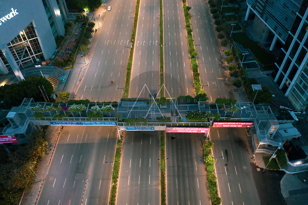 Aerial view of Gurugram financial district with tall building at dusk in Haryana state during lockdown. india.