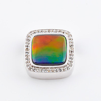 Product photography of jewelry made with ammolite precious gems for Korite International for use on print collateral and digital marketing tools.<br /> <br /> ©2016, Sean Phillips<br /> http://www.RiverwoodPhotography.com