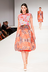 © Licensed to London News Pictures. 30/05/2015. London, UK. A model walks the runway during the UCA Rochester fashion show at Graduate Fashion Week 2015 wearing the collection of graduate student Emily Ramsell. Graduate Fashion Week takes place from 30 May to 2 June 2015 at the Old Truman Brewery, Brick Lane. Photo credit : Bettina Strenske/LNP