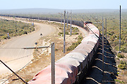 Between 300 and 400 wagons of iron ore are pulled by up to eight locomotives in a huge behemoth of a train on this Ore Export Line. The train connects the iron ore mines near Sishen in the Northern Cape with the port at Saldanha Bay in the Western Cape. I've never seen such a long train ever. The total vehicle length stretches for over three miles and took an age to pass under the bridge below my feet. Everything about Africa is huge but this gigantic train really gave some emphasis to the vast distances between destinations here in South Africa.