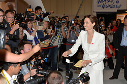 Image ©Licensed to i-Images Picture Agency. 10/06/2014. <br /> <br /> Pictured is Angelina Jolie who greeted a fan who grabbed her attention and passed her an envelope while participating in a photo call.<br /> <br /> Angelina Jolie and William Hague attend the Global Summit to End Sexual Violence in Conflict at The ExCel, London, UK.<br /> <br /> Picture by Ben Stevens / i-Images