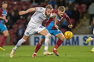 Wycombe Wanderers defender Jason McCarthy (26) battles with Scunthorpe United forward George Thomas (18) during the EFL Sky Bet League 1 match between Scunthorpe United and Wycombe Wanderers at Glanford Park, Scunthorpe, England on 29 December 2018.