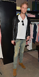 JACK FOX at a party to celebrate the reopening of the Lacoste Premium Store at 233 Regent Street, London on 28th May 2014.