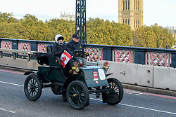 © Licensed to London News Pictures. 03/11/2019. LONDON, UK.London, UK. Retired oil executive Ron Carey, aged 80, drives his 1903 Knox Porcupine, across Lambeth Bridge during the 123rd Bonhams London to Brighton Veteran Car Run, which took place on 3 November, accompanied by his wife Billi. It has been reported that they were later involved in a car accident on the M23 which resulted in Mr Carey losing his life and his wife critically injured in hospital. The 116-year-old car was part of Mr Carey's £3.8million car collection, most of which is housed at the Gasoline Alley Museum in his native Calgary. Photo credit: Stephen Chung/LNP