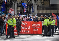 © Licensed to London News Pictures. 25/09/2019. London, UK. Large police numbers and Pro and anti Brexit protestors gather outside the Houses of Parliament in Westminster on the day that MPs return. The Supreme Court in London yesterday ruled that Parliament had been suspended illegally after British Prime Minster Boris Johnson prorogued parliament just weeks before the UK is due to leave the EU on October 31st. Photo credit: Ben Cawthra/LNP