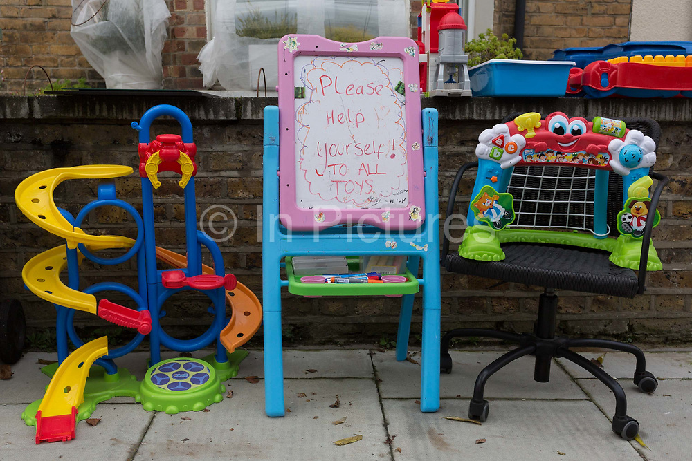 A selection of unwanted childrens toys and games are left outside a residential home, urging local south Londoners to come and help themselves, on 2nd December 2019, in London, England.