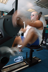 Access to services, Disabled man in the gym; using body building sports equipment,