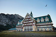 An eagle soars over the Prince of Wales Hotel overlooking Waterton Lake, Alberta, Canada.
