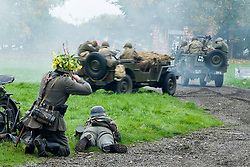 Re-enactors portrayiing Germans fire on members of the 82nd Airborne Division who are in Willys Jeeps during a Battle re-enactment on Pickering Showground<br /> <br /> 17/18 October 2015<br />  Image © Paul David Drabble <br />  www.pauldaviddrabble.co.uk