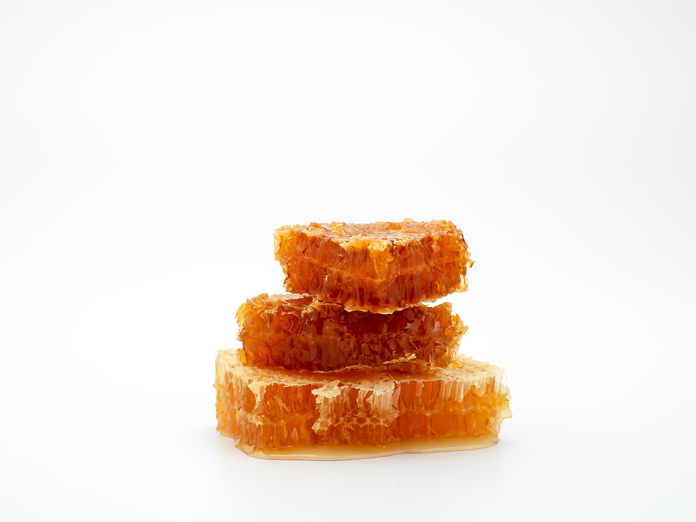 pieces of honeycomb on a white background