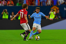Manchester United midfielder Daley Blind (17) battle for the ball from Manchester City midfielder Patrick Roberts (27) during the International Champions Cup match between Manchester United and Manchester City at NRG Stadium in Houston, Texas