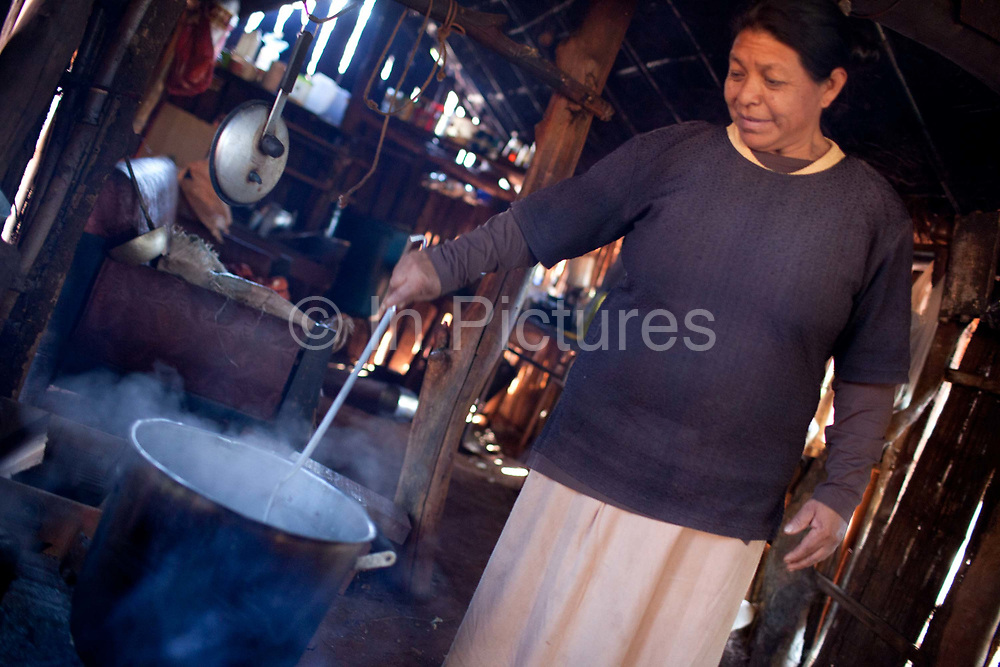 Guarani woman cooking in her traditional hut. The Guarani are one of the most populous indigenous populations in Brazil, but with the least amount of land. They mostly live in the State of Mato Grosso do Sul and Mato Grosso. Their tradtional way of life and ancestral land is increasingly at risk from large scale agribusiness and agriculture. There have been recorded cases and allegations of violence between owners of large farms and the Guarani communities in this region.