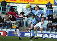 Photo: Paul Thomas, Digitalsport<br /> Coventry City v Burnley, Highfield Road, Coventry. Coca Cola Championship. 12/02/2005. Micah Hyde and Ian Moore go for the ball