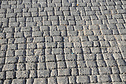 close up of a street paved with paving stones