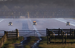 © Licensed to London News Pictures. 20/12/2018. London, UK. Emergency vehicles check the runway surface at Gatwick airport. Flights have been cancelled and thousands of passengers have been delayed after the airport closed due to two drones being spotted nearby. Photo credit: Peter Macdiarmid/LNP