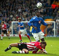 Photo: Scott Heavey.<br /> Portsmouth v Southampton. FA Barclaycard Premeirship. 21/03/2004.<br /> Yakubu gets the better of Claus Lundekvaum