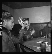 """These stunning photos of the Tuskegee Airmen show cool dedication in the face of wartime segregation<br /> <br /> The Tuskegee Airmen were determined men who volunteered to be America's first Black military airmen and were trained as pilots, navigators, & bombardiers.<br /> <br /> Photographer Toni Frissell captured these men with a mission<br /> <br /> By the time World War II broke out, African Americans had already been pressing for access to elite military training for decades. They knew the U.S. government was not keen on integrating its military—a stance so pervasive that one black pilot even enlisted in the French air service after being rejected by his own. But the interwar period saw civil rights groups and professional organizations like the NAACP pressing for greater access to military training, and in 1939 they were rewarded when a House Appropriations Bill earmarked funds for training African American pilots at any civilian flight schools that would have them. The historically black university in Tuskegee, Alabama, had such a program. Its graduates would come to form an elite squadron of all-black military pilots, known colloquially as the """"Tuskegee Airmen,"""" officially the 332nd Fighter and the 477th Bombardment groups. <br /> <br /> In April 1943 the airmen shipped out to North Africa and Sicily, where they promptly garnered distinction for their effectiveness in clearing Axis forces from strategic Mediterranean naval routes. Soon the 332nd was escorting bomber missions into central Europe and Germany, shooting down the Luftwaffe's technologically superior fighter jets and earning the nickname """"Red-Tail Angels"""" for their aircrafts' custom crimson-dipped nose and tail paint jobs.<br /> <br /> Antoinette """"Toni"""" Frissell was a Manhattan fashion photographer who volunteered for war in 1941 and became an official chronicler of the American Red Cross and Women's Army Corps activities in Europe, producing inspirational images for use as propaganda. To that ex"""