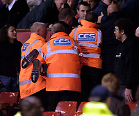 Photo: Jed Wee.<br /> Manchester Utd v Barnet. Carling Cup. 26/10/2005.<br /> <br /> A disturbance in the crowd rumoured to be related to fans unhappy with the Glazer brothers sees stewards having to forcible restrain some fans.