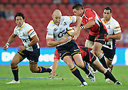 Brumbies centre, Stirling Mortlock is tackled by Barry Goodes and Andre Pretorius in the Super 14 match between the Lions and the Brumbies that took place on Saturday 21 March 2009 at Coca-Cola Park in Johannesburg South Africa. The Lions won this Super 14 match against the Brumbies 25 - 17.  <br /> Photographer : Anton de Villiers / SASPA
