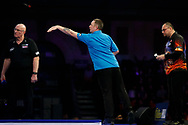 Alan Tabern throwing, Raymond Smith looking on, during the PDC World Championship darts at Alexandra Palace, London, United Kingdom on 14 December 2018.