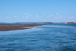 A charter boat moors near the main channel at Montgomery Reef on the Kimberley coast.  At 292km2, Montgomery is Australia's largest inshore reef.