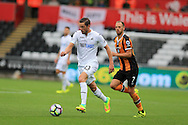 Gylfi Sigurdsson of Swansea city (l)  in action. Premier league match, Swansea city v Hull city at the Liberty Stadium in Swansea, South Wales on Saturday 20th August 2016.<br /> pic by Andrew Orchard, Andrew Orchard sports photography.