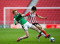 Football - 2020 / 2021 Sky Bet League One - Sunderland vs Lincoln City - Stadium of Light<br /> <br /> Luke O'Nien of Sunderland vies with Callum Morton of Lincoln City<br /> <br /> Credit: COLORSPORT/BRUCE WHITE