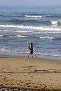 Treasure Hunter and Surfers in Huntington Beach California