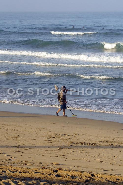 Treasure Hunter and Surfers in Huntington Beach California