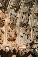 .South Porch, Right Portal archivolts c. 1145. Cathedral of Chartres, France. Gothic statues of the archivolts on the lower register of archivolts are miracles of Gilles, including the Mass of St. Gilles (right). The other archivolts show various Confessors.. A UNESCO World Heritage Site. . .<br /> <br /> Visit our MEDIEVAL ART PHOTO COLLECTIONS for more   photos  to download or buy as prints https://funkystock.photoshelter.com/gallery-collection/Medieval-Middle-Ages-Art-Artefacts-Antiquities-Pictures-Images-of/C0000YpKXiAHnG2k