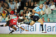 Waratahs winger Drew Mitchell gets away from Wigan Pekeur to score a try. Super 14 Rugby Union, Waratahs v Lions, Sydney Football Stadium, Australia. Friday 12 March 2010. Photo: Clay Cross/PHOTOSPORT