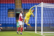 Cheltenham Town goalkeeper Josh Griffiths (20) makes a save during the EFL Sky Bet League 2 match between Bolton Wanderers and Cheltenham Town at the University of  Bolton Stadium, Bolton, England on 16 January 2021.