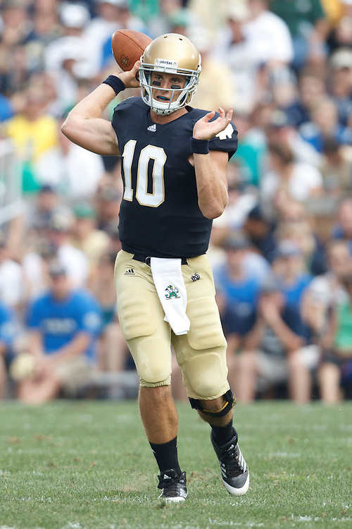 Notre Dame quarterback Dayne Crist (#10) throws pass in action during NCAA football game between Notre Dame and South Florida.  The South Florida Bulls defeated the Notre Dame Fighting Irish 23-20 in game at Notre Dame Stadium in South Bend, Indiana.