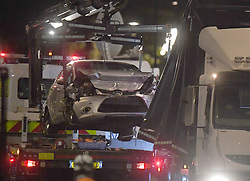 Police recover the car driven by a 29-year-old man, who is a UK national, who was arrested on suspicion of preparing an act of terror after the silver Ford Fiesta he was driving collided with cyclists and pedestrians before crashing into a security barrier outside the Houses of Parliament in central London just before 7.40am on Tuesday.