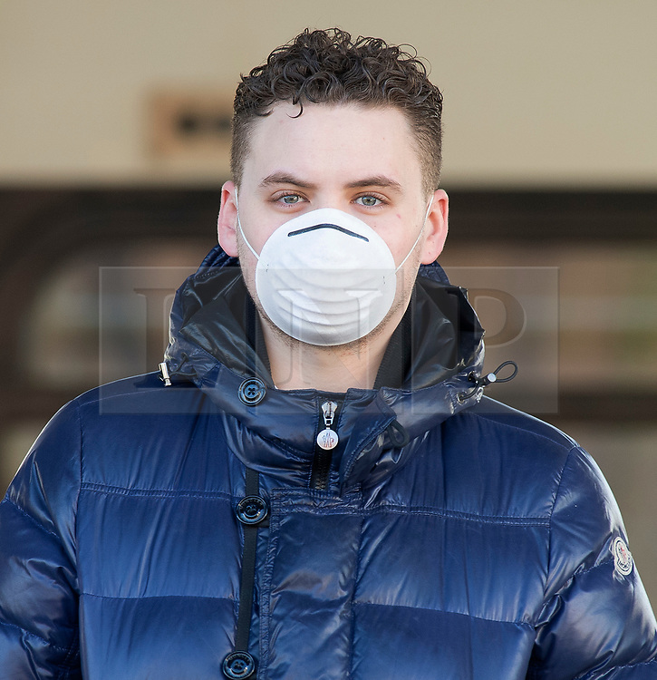 ©Licensed to London News Pictures 13/03/2020<br /> Pettswood, UK. A commuter wearing a protective face mask. London commuters at Pettswood train station this morning in Pettswood, Kent are keeping their distance from each other by standing a meter apart as the Coronavirus threat continues in the UK. Commuter numbers are down as many work from home.  Photo credit: Grant Falvey/LNP