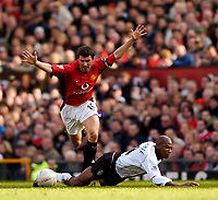 Photo. Jed Wee, Digitalsport<br /> Manchester United v Fulham, FA Cup, Old Trafford, Manchester. 06/03/2004.<br /> Man Utd's Roy Keane (L) wins a scrap illegally against Fulham's Luis Boa Morte.
