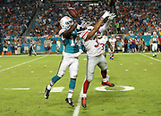 New York Giants defensive back Trevin Wade (31) jumps and breaks up a deep pass intended for Miami Dolphins wide receiver Jarvis Landry (14) in the fourth quarter during the NFL week 14 regular season football game against the Miami Dolphins on Monday, Dec. 14, 2015 in Miami Gardens, Fla. The Giants won the game 31-24. (©Paul Anthony Spinelli)