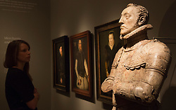 "© Licensed to London News Pictures. 09/10/2013. London, England. A museum worker stands in front of the ""Tomb Sculpture of Piero Caponi"". Press preview of the exhibition ""Elizabeth I & Her People"" at the National Portrait Gallery which explores the remarkable reign of Elizabeth I through the lives and portraiture of her subjects. Exhibition runs from 10 October 2013 to 5 January 2014. Photo credit: Bettina Strenske/LNP"