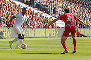 Leeds United forward Jordan Botaka takes on Middlesbrough defender George Friend during the Sky Bet Championship match between Middlesbrough and Leeds United at the Riverside Stadium, Middlesbrough, England on 27 September 2015. Photo by Simon Davies.