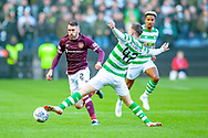 Callum McGregor(#42) of Celtic FC tackles Michael Smith (#2) of Heart of Midlothian during the Betfred League Cup semi-final match between Heart of Midlothian FC and Celtic FC at the BT Murrayfield Stadium, Edinburgh, Scotland on 28 October 2018.