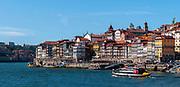 Panoramic cityscape of Ribeira, Old Town, Porto, Portugal as seen from Vila Nova de Gaia across the Douro River