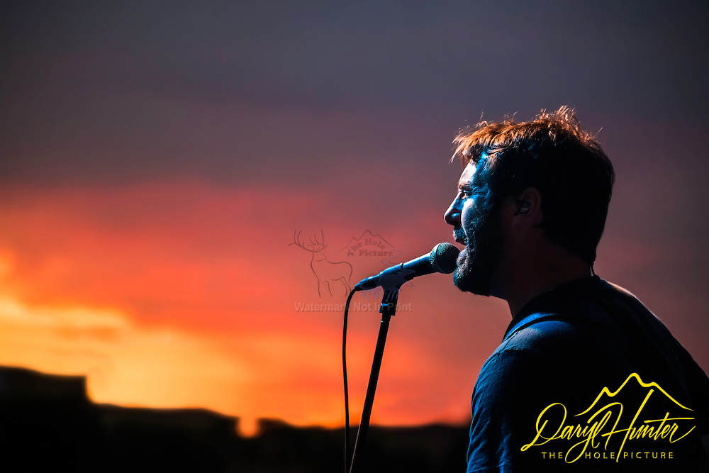 Country singer, Shawn Smith of the Jason Michael Carroll Band, singing into the sunset in Naples Italy.