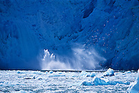 Calving on South Sawyer Glacier at Tracy Arm, Alaska.  When slabs of ice break away from the glacier and drop into the sea it is called calving.